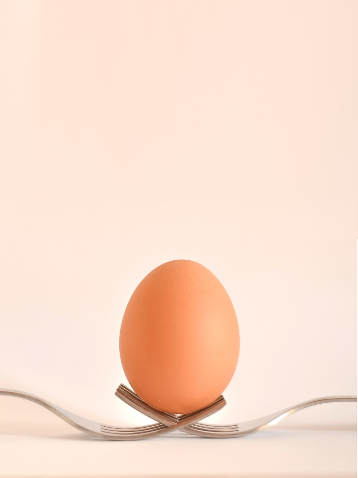Egg balanced on forks